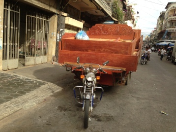 Tuk tuks are apparently great for moving furniture