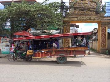 Tuk tuk meets city bus