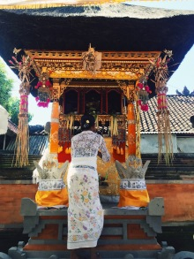 Balinese woman leaving an offering at the wedding ceremony