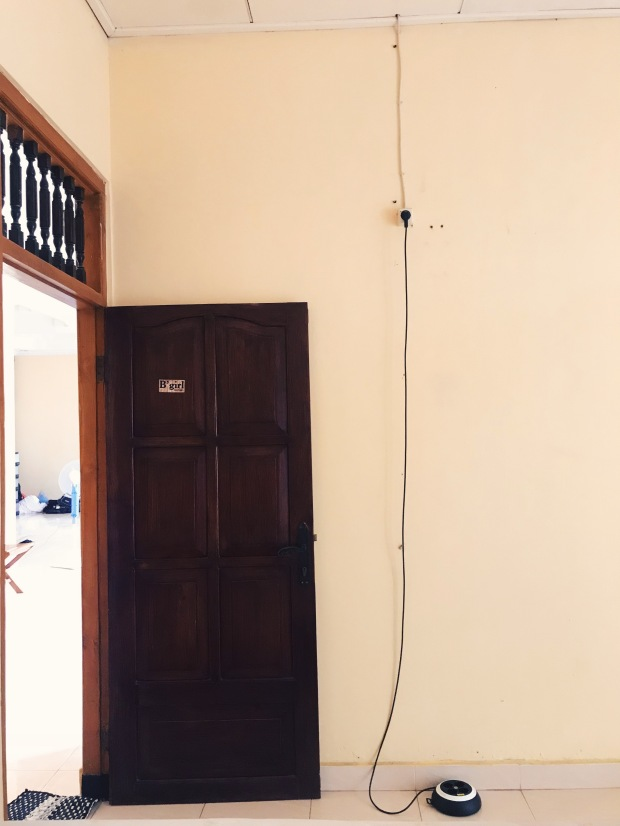 Only outlet in the room literally above the door