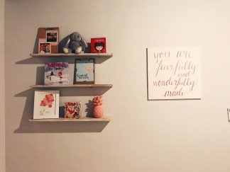 Canvas and shelving in baby room