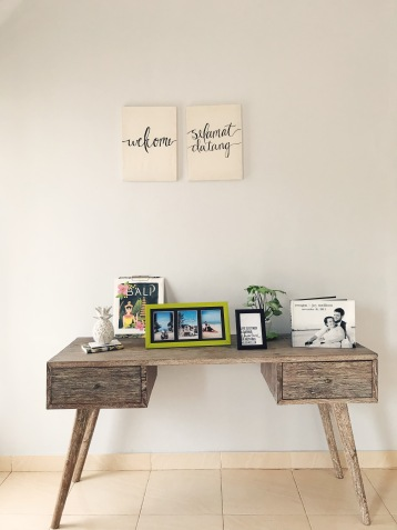 Foyer table and canvases