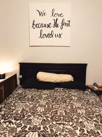 Brush lettered canvas in master bedroom